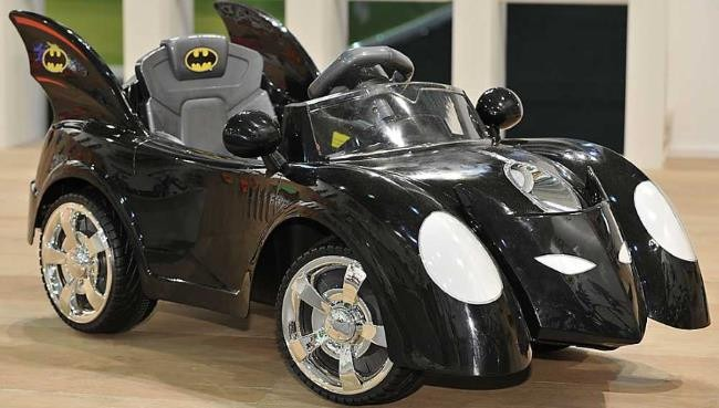 Batmobile Electric Ride-On Car 6v on Wooden Floor